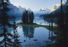 Spirit Island is a tiny island in Maligne Lake in Jasper National Park. This landmark is the destination of boat trips across Maligne Lake, a view many people associate with the Canadian Rockies. This landmark is one of the most famous views of the Canadian Rockies.