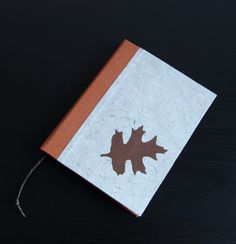 Handmade notebook covered with canvas and handmade paper with brown paper leaf, 96 white pages, some of them is with green leaf stamp
