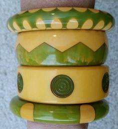 Love green vintage bakelite bangles.