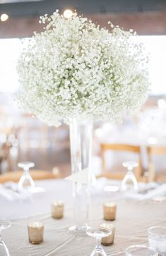 Babies breath centerpieces: Using floral foam to get that perfect shape and have no stems showing.