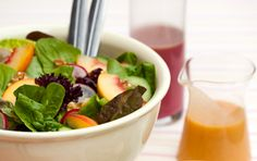 Peaches and walnuts make a summery, juicy, flavorful salad dressing.  Add a little sugar, salt and pepper to dressing.