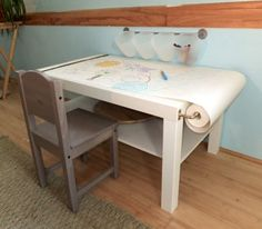 DIY Arts & Craft Table for Kids on a Budget - paper roll, wall-mounted buckets for supplies