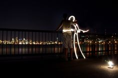 Painting with light!  Website: http://www.reddit.com/r/Seattle/comments/odlez/gasworks_light_painting_xpost_from_rlightgraffiti/