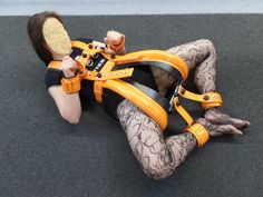 Black/orange spreader pant from bestfixsystems with additional hand and foot restraints...She looks marvelous!