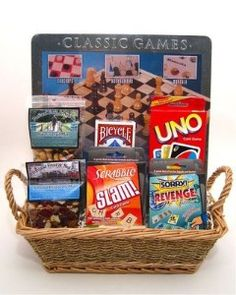 game night gift basket is filled with some terrific games for family Camping Gift Baskets, Diy Gift Baskets, Raffle Baskets, Gift Baskets For Kids, Gift Basket Ideas, Game Basket, Homemade Gift Baskets, Anniversary Gift Baskets, 40th Anniversary Gifts
