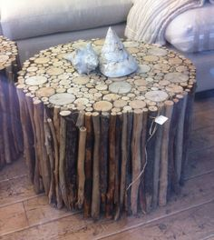 Driftwood on the outside and cut the tops of logs for the top piece. Add a piece of glass on top. Would this work around a base of two tires with a cheap round wood table top and bottom? Add wheels on the bottom?