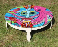 Love the octopus.Octopus Face Painting on re-done wooden coffee table.