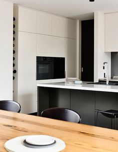 I like the detail for storing wine bottles in that narrow space to the left of what appears to be the oven.