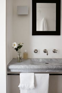 Warm white walls and grey-toned marble brings a neutral interest to this quaint bathroom setup. #modernbathroom #simplebathroom #neutralbathroom
