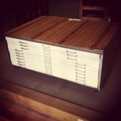Industrial architect plan drawers. Stripped metal sides, wooden top, white drawers <3 -The General Store