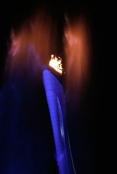 Water dances under the Olympic Cauldron at the Olympic Park during the Opening Ceremony of the Sochi 2014 Winter Olympics at Fisht Olympic S...