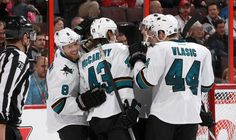 The San Jose Sharks celebrate forward Joe Pavelski's third period goal (Oct. 27, 2013).