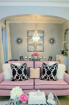 I want a pink sofa with fluffy white pillows.