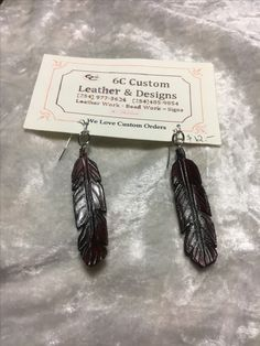 https://www.etsy.com/listing/495350651/hand-tooled-leather-feather-earrings?ref=related-2