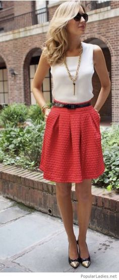 White top and a red skirt