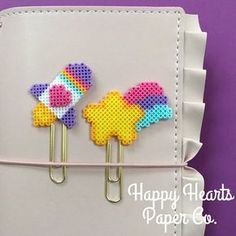 These pastel cuties are so much fun, and will make the day of any book lover or planner around. The planner clip can be used in your planner to mark the week and add decoration, or used as a bookmark to keep track of where you are in your favorite novel or magazine. I personally