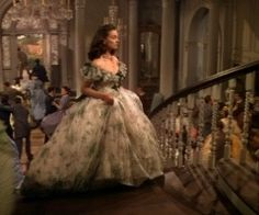 After war has been declared, Scarlett walks up the stairs to look out, and see's Ashley kiss Melanie goodbye. She then decides to marry Charles Hamilton to get back at Ashley for rejecting her.