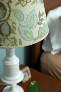 How to redo a lamp shade using fabric, bias tape, spray adhesive, and glue.