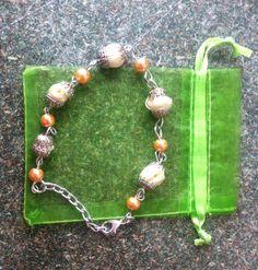 Pulsera perlas y rosas $20.000 ref. 0-47