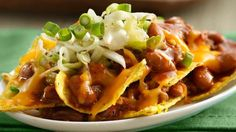 The flavors of Kansas City BBQ pulled pork inspire this delicious nacho platter, complete with layers of chips, beans and cheese.