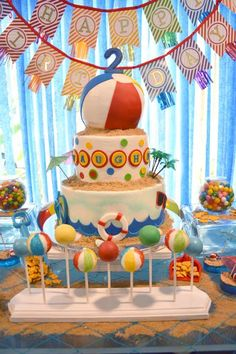 A Pool Party Splash Birthday Cake with beach ball cake pops, gold fish and colorful decor. --love the blue streamers! Beach Ball Birthday, Beach Ball Party, Beach Ball Cake, Summer Birthday, Boy Pool Parties, Pool Party Kids, Boy Birthday Parties, Birthday Cake, Birthday Ideas
