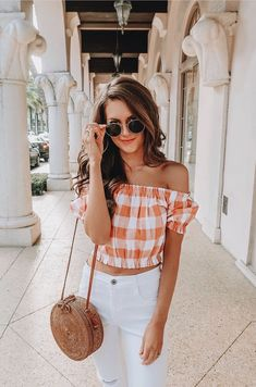 Cute off the shoulder orange and white checked top with white jeans.