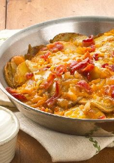 Skillet Potatoes with Bacon & Cheddar – The Yukon Gold potatoes get top billing in this all-star skillet dish, but we give props to the bacon, cheddar, sour cream and onion, too. Team effort!