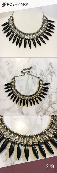Ebony & Gunmetal Statement Necklace Ebony and gunmetal statement necklace  Boutique necklace Ebony/black spikes  Gunmetal/dark silver chain Crystal rhinestones Adjustable chain  Measurements: Will be posted asap.   Excellent, like-new condition. Jewelry Necklaces