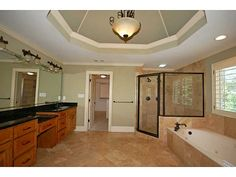 Luxurious master bath features his/hers cherry vanities, granite tops, travertine flooring, large jetted tub and separate shower. *Contact Karen Cannon Realtors 770-352-9658