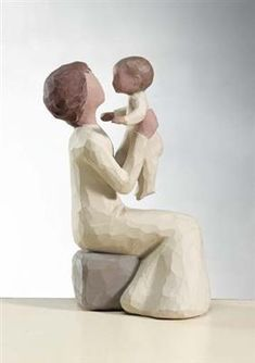 Grandmother figurine by Willow Tree. The joy that fills a woman's heart at the sight of her grandchild is hard to describe. Her heart swells to a size bigger than she ever thought possible, her natural instincts to preserve and protect grow fiercely, and she becomes both a hero and a best friend. #willowtree #grandmother @demdaco
