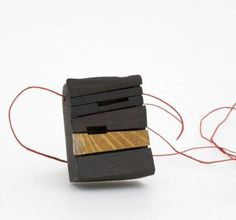 JORGE CASTANON-AR-   Necklace: Africa  Found wood, linen