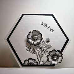 handmade card from Eileen's Crafty Zone ... elergant look in black and white ... hexagon shaped card ... luv how the flowers are stamped twice with the second one cut out and shaped with crystal balls in the center ... fabulous card!
