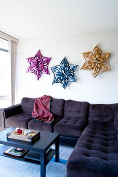We spent Thanksgiving with family in Idaho, and my super awesome sister-in-law showed me how to make these ginormous paper snowflakes in just a few easy steps. I could barely contain my excitement when I learned how to make these, and I couldn't wait to get back home and share this with all of you! I have a small apartment so I only made 3 snowflakes,  but if you had a house these snowflakes would make for amazing porch decorations! Talk about Holiday curb envy!   So the first thing I did…