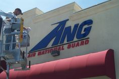Foam letter sign for the Air National Guard in Mountain View, California. Not easy getting over that awning. Custom Signs 408-605-3435 / www.clamkinman@comcast.net