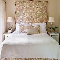 Bold Statement    To make the headboard in the master bedroom, designer Blair Gordon enlarged a photograph of an antique French mirror, laser-cut a piece of wood to match the shape, and upholstered it in a large-scale print. Nailhead trim not only echoes the detailing of the side tables but also highlights the headboard's oversize, dramatic silhouette.