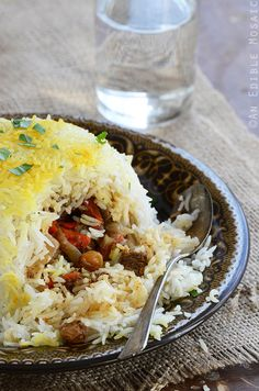 Not long after we married, my husband introduced me to pilaf-style biryani, one of his favorite rice dishes that has meat and veggies cooked together with the rice; topped with toasted almonds or o...