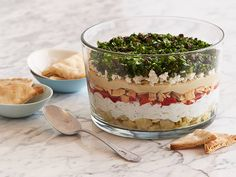 How to Make 7-Layer Greek Dip:  Artichokes, yogurt/cuke dip, pita chips, hummus, feta-- YUM!