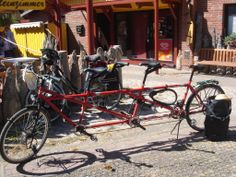 red bike for 3 persons