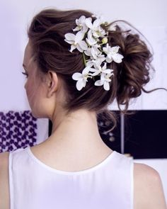 """See the """"For the Romantic"""" in our Wedding Hairstyles for Bows, Buds, Tiaras, and More From the Spring 2016 Bridal Shows gallery"""