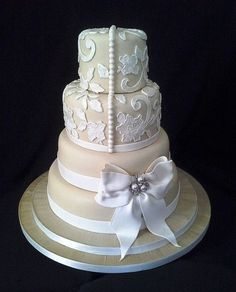 Round Wedding Cakes - Champagne coloured fondant decorated with lace and a gum paste bow.