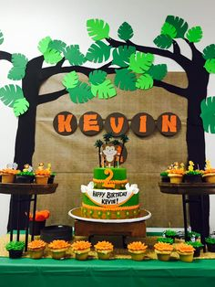 Jungle themed birthday party with DIY decorations, backdrop, and yummy desserts