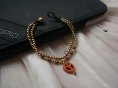 A personal favorite from my Etsy shop https://www.etsy.com/listing/150249526/2-in-1-chains-orange-peace-pendant-gold