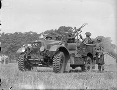 Morris-Commercial 15 cwt truck and men of the 1st Battalion Cameron Highlanders practise with a Bren gun fitted on an anti-aircraft mounting, Aldershot 1939