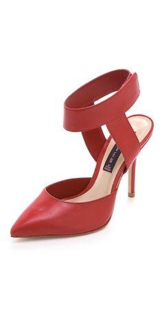 red pointy toe pumps / Steven Revolvir