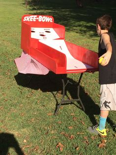 Always a carnival favorite! Re-create your favorite midway experience on a smaller scale! Try to roll the three balls up the ramp and into the holes to get the highest score you can. Balls return automatically after being thrown. The head unit measures 24 x 24. The ramp section is 24 inches wide and 48 inches long. The game can either be played on the ground or sitting on a 6 foot table. Each game is built-to-order and requires a few days of build time. Orders outside the continental US…