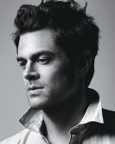 Johnny Knoxville --- I don't know why I think he's so sexy - he's a jacka$$  ;)  lol