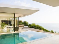 Modern seafront residence located in Spain, designed in 2016 by JLE Arquitectos. Infinity Pool, Loft, Luxury Homes, Sweet Home, Exterior, Flooring, Outdoor Decor, Modern, Door Ideas