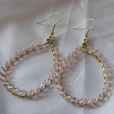 Craft a delicate pair of DIY earrings with this tutorial for Beautiful Wire Wrapped Teardrop Earrings. Precious in pale pink, this dainty teardrop earrings designs are subtle, yet style stunning. Everyone will marvel at these glimmering earrings.