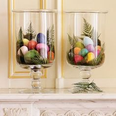 colorful eggs in hurricane vases for Easter