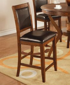 Set of Two Nelms 24 Inch Bar Stool - Coaster 102179 by Coaster Home Furnishings. $179.70. stately flared back legs. lovely upholstered seat and back. solid wood frame. Create a striking contemporary aesthetic in your dining room with this 24 inch bar stool. It features a lovely upholstered seat and back and stately flared back legs. Combine this bar stool with the counter table from this collection for a complete set.This item will make a great addition to your home...